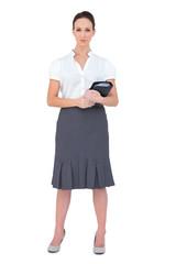Content businesswoman holding datebook