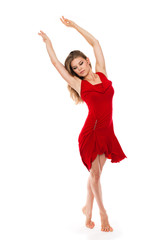 Classical dancer in ballerina pose wearing red dress, isolated