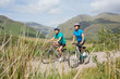 Fit attractive couple cycling together