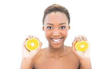 Smiling natural beauty holding orange slices