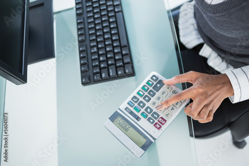 Close up on businesswoman using calculator