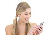 Laughing young blonde woman using a mobile phone