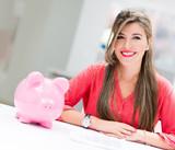 Business woman with a piggybank