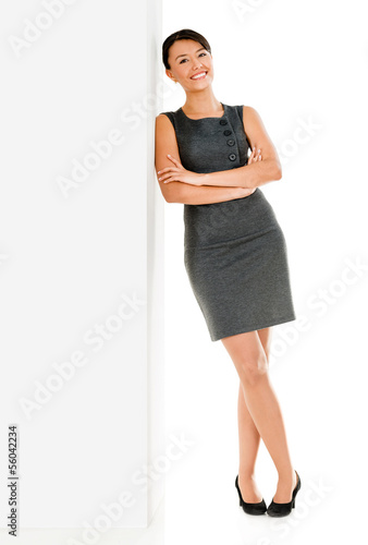 Business woman leaning on the wall