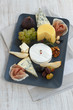 Various types of cheese, ham and fruits