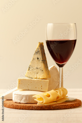 Various types of cheese and red wine