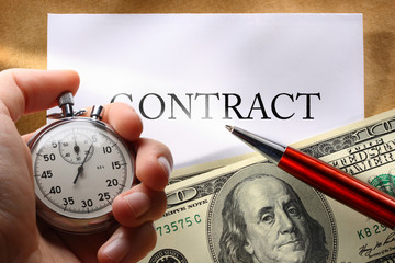 Contract with money and pen