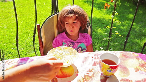Little girl eating cottage cheese