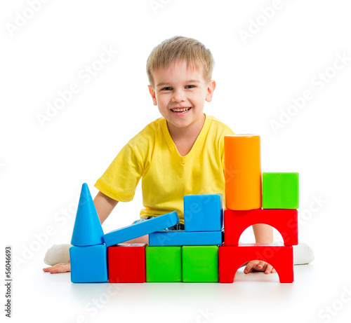 kid playing with building blocks