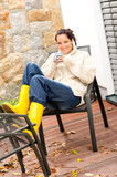 Cheerful woman enjoy tea relaxing veranda autumn