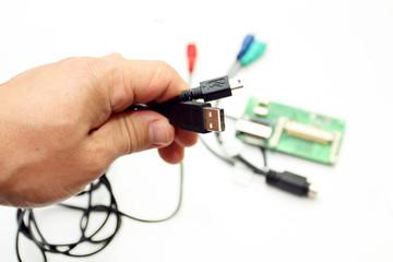 The interface USB, miniUSB, HDMI in a hand