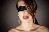 blindfolded woman licking her lips