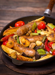 Sausages and vegetables in the pan