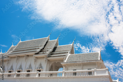 White pagoda on blue sky in temple at wat Thailand