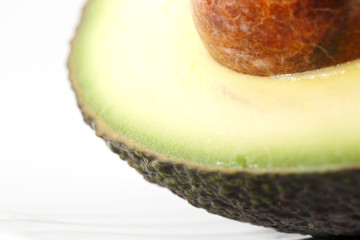 A portion of a fresh organic avocado against a white background