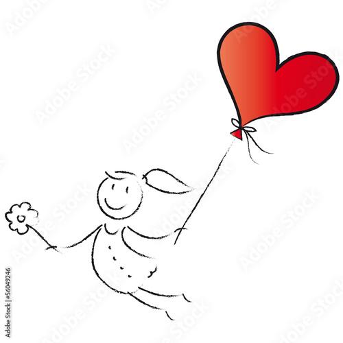 Mädchen fliegt mit Herzluftballon