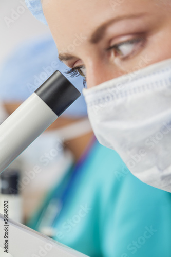 Female Woman Scientist Using Microscope in Laboratory