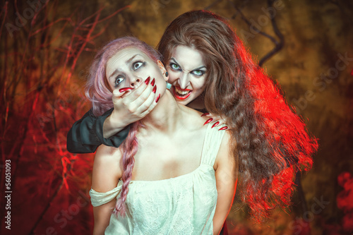 Halloween vampire and her victim
