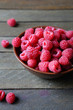 ripe raspberries in a bowl on the table