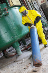 technician in  uniform,  dealing with steel cylinder wh gas