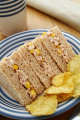 Tuna and sweetcorn sandwich with potato chips
