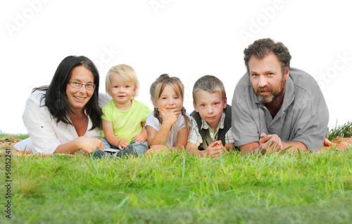 Young family on the grass against white background.