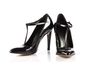 Elegant high heel shoes on white background. Black footwear.