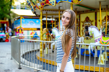 Beautiful woman in the amusement park