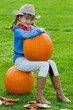 Harvest of pumpkins - girl and large pumpkin