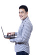 Smiling asian businessman with laptop