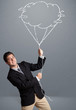 Handsome man holding cloud balloon drawing