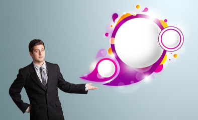 Handsome man presenting abstract speech bubble copy space