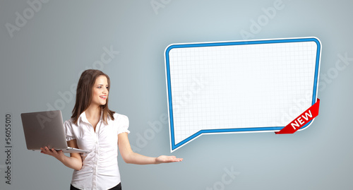 young woman holding a laptop and presenting modern speech bubble