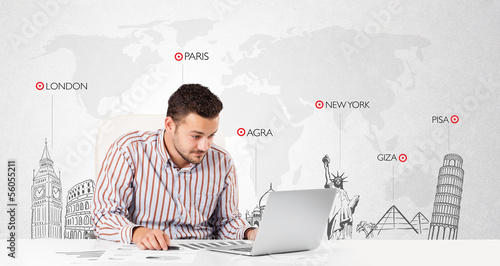 Businessman with world map and major landmarks of the world