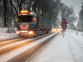 fast moving heavy goods vehicle in a snow storm