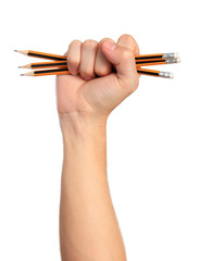 Fist with pencils, isolated