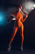 Sexy girl in orange latex catsuit, sci-fi theme