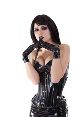 Portrait of gothic girl wearing latex clothes