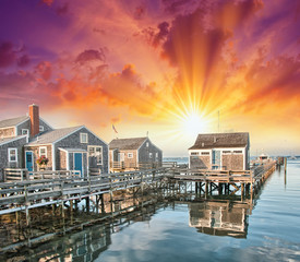 Nantucket, MA. Beautiful Port view with Wooden Homes at sunset