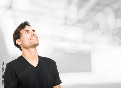 Handsome man looking up