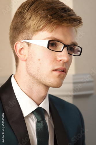 Portrait young handsome stylish man indoor