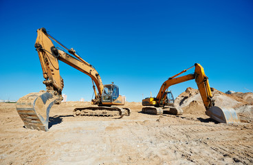 track-type loader excavators at work
