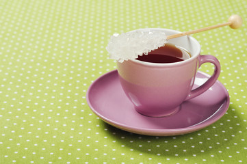 Tea in cup with candy sugar