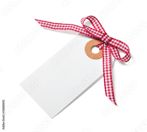 White tag with red ribbon