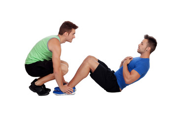 Personal trainer and boy making abdominal