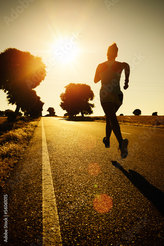Woman running on sunset