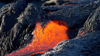 Volcanic Lava Moving Over Barren Landscape Hawaii
