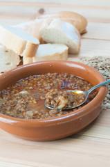 Brown lentil stew in bowl with vegetable