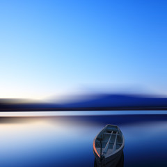 Single boat in long exposure in dusk