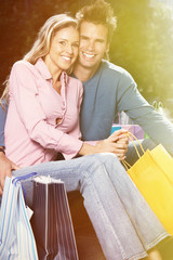 Couple with shopping bags.